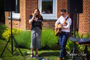 Acoustic duo performing at a wedding reception